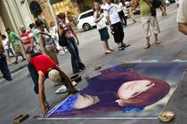 街头艺术家画你的照片