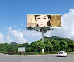 蓝天白云下的路边广告牌照片合成